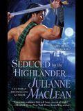 Seduced by the Highlander (The Highlander Series)