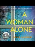 A Woman Alone Lib/E
